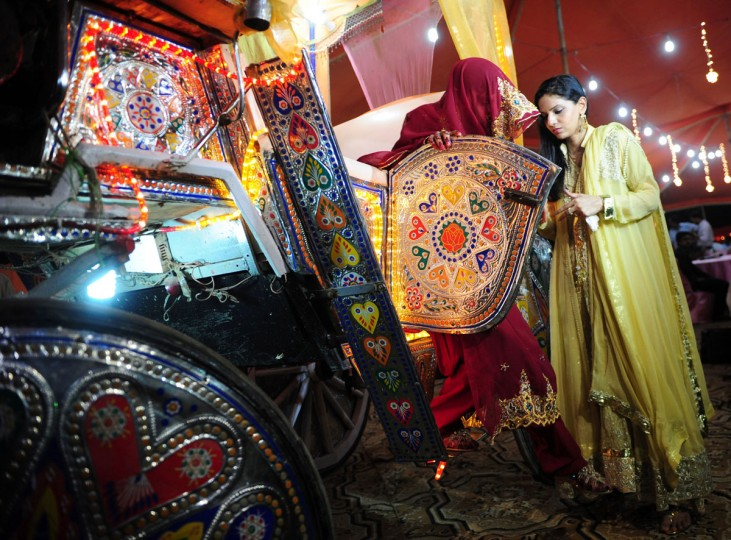A Pakistani bride arrives to attend a mass-wedding ceremony in Karachi late May 9, 2016. (ASIF HASSAN/AFP/Getty Images)