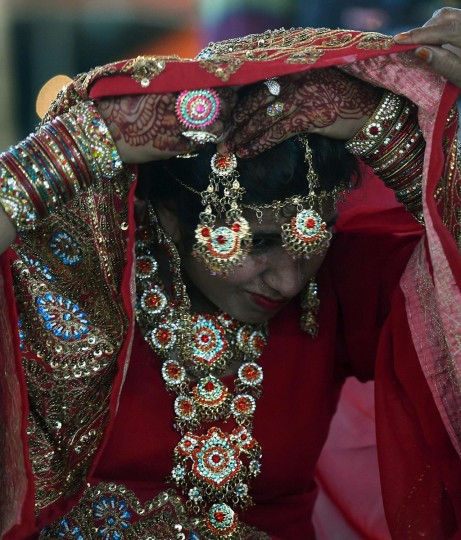 A Pakistani bride adjusts a jhoomar as she attends a mass-wedding ceremony in Karachi late May 9, 2016. (ASIF HASSAN/AFP/Getty Images)