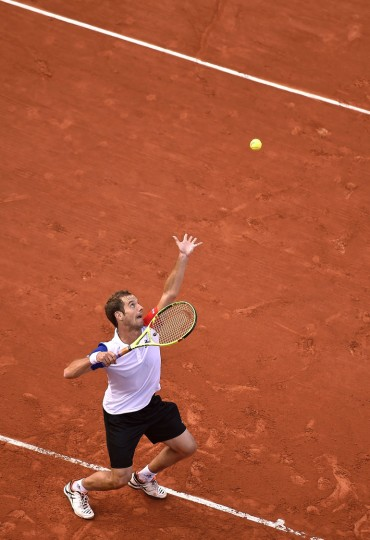 France's Richard Gasquet serves the ball to Brazil's Thomaz Belluci during their men's first round match at the Roland Garros 2016 French Tennis Open in Paris on May 23, 2016. (Eric Feferberg/AFP/Getty Images)