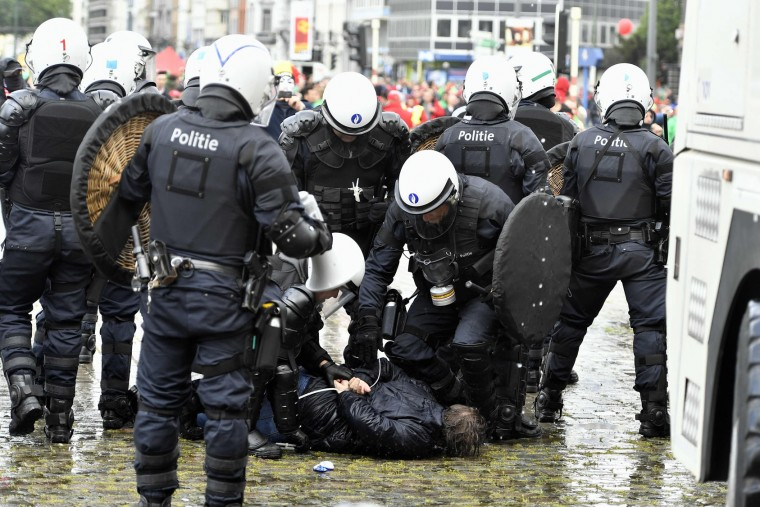 Belgium's riot police arrest a demonstrator during a national anti-austerity demonstration on May 24, 2016, in Brussels. Belgian trade unions called for mass protests against the centre-right government's proposed work reforms as they plan rallies and strikes over the next few months. (Eric Lalmand/AFP/Getty Images)