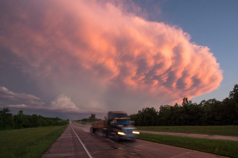 A truck drives as a supercell storm system baring multiple tornado warnings expands across the sky near Hugo, Oklahoma on May 9, 2016. A series of tornadoes struck rural Oklahoma on May 9th. One person is confirmed dead. (Josh Edelson/AFP/Getty Images)