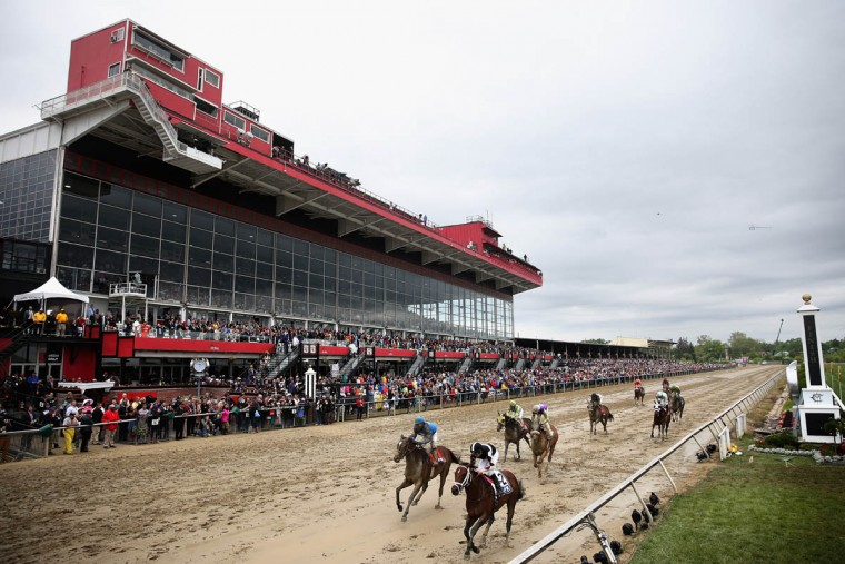 Horses race prior to the 141st running of the Preakness Stakes at Pimlico Race Course on May 21, 2016 in Baltimore, Maryland. (Photo by Patrick Smith/Getty Images)
