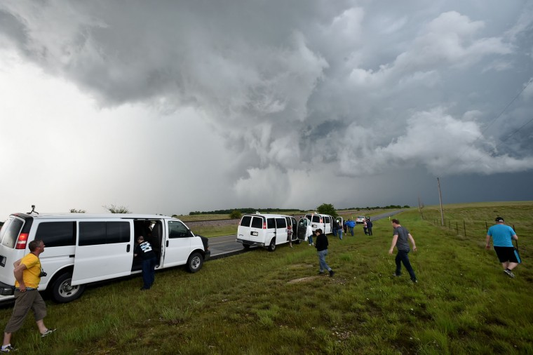 Storm Chasers from Silver Lining Tours scramble for a viewable position as a rain-wrapped tornado approaches near Hickory, Oklahoma on May 09, 2016. (Josh Edelson/AFP/Getty Images)