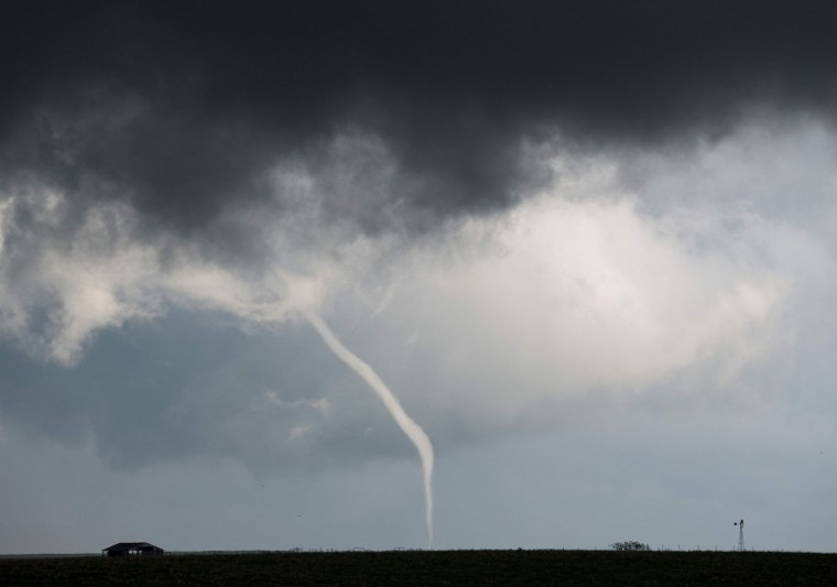 A thin tornado touches down outside of Hickory in rural Oklahoma on May 9, 2016. A series of tornadoes struck rural Oklahoma on May 9th. One person is confirmed dead. (Josh Edelson/AFP/Getty Images)