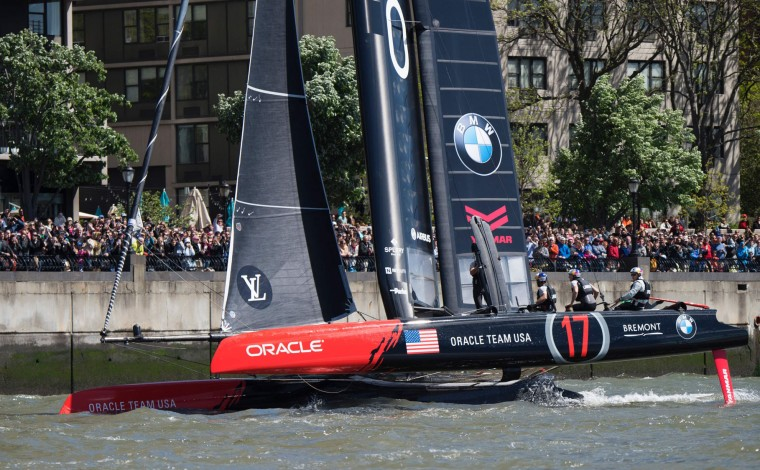 Oracle Team USA crosses the finish line of the second race of the Louis Vuitton America's Cup World Series New York May 8, 2016 in New York. (Don Emmert/AFP/Getty Images)