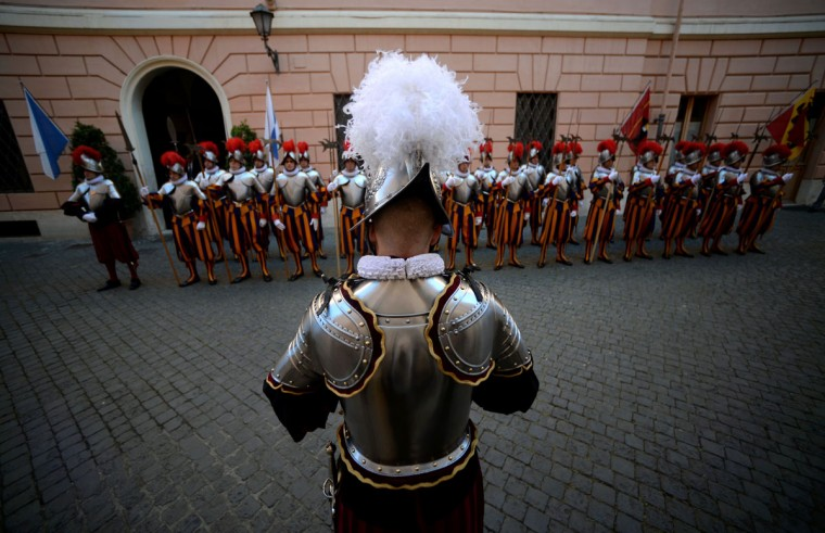 New swiss guard stand in front of thier superior prior to a swearing-in ceremony in Vatican City, on May 6, 2016. The annual swearing in ceremony for the new papal Swiss guards takes place on May 6, commemorating the 147 who died defending Pope Clement VII on the same day in 1527 during the sack of Rome. (AFP Photo/Filippo Monteforte)
