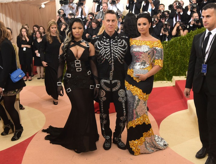 """Nicki Minaj, from left, Jeremy Scott and Demi Lovato arrive at The Metropolitan Museum of Art Costume Institute Benefit Gala, celebrating the opening of """"Manus x Machina: Fashion in an Age of Technology"""" on Monday, May 2, 2016, in New York. (Photo by Charles Sykes/Invision/AP)"""