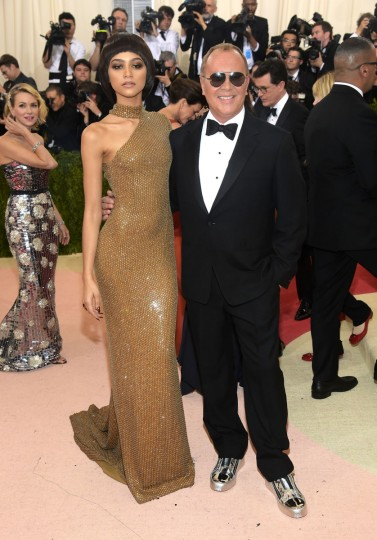 """Zendaya, left, and Michael Kors arrive at The Metropolitan Museum of Art Costume Institute Benefit Gala, celebrating the opening of """"Manus x Machina: Fashion in an Age of Technology"""" on Monday, May 2, 2016, in New York. (Photo by Charles Sykes/Invision/AP)"""