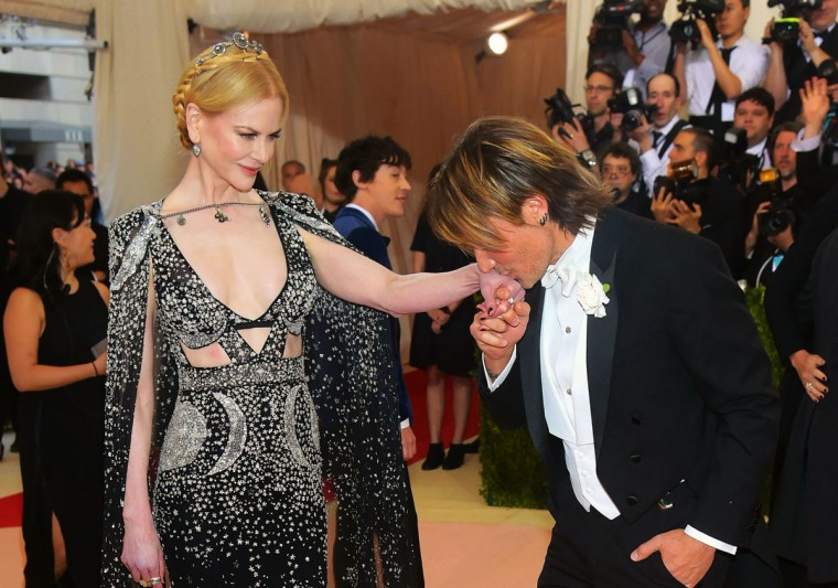 """Nicole Kidman, left, and Keith Urban arrive at The Metropolitan Museum of Art Costume Institute Benefit Gala, celebrating the opening of """"Manus x Machina: Fashion in an Age of Technology"""" on Monday, May 2, 2016, in New York. (Photo by Charles Sykes/Invision/AP)"""