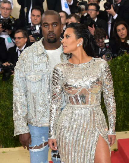 """Kanye West, left, and Kim Kardashian arrive at The Metropolitan Museum of Art Costume Institute Benefit Gala, celebrating the opening of """"Manus x Machina: Fashion in an Age of Technology"""" on Monday, May 2, 2016, in New York. (Photo by Charles Sykes/Invision/AP)"""