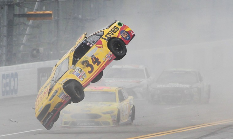 Chris Buescher (34) wrecks during the NASCAR Talladega auto race at Talladega Superspeedway, Sunday, May 1, 2016, in Talladega, Ala. (AP Photo/Greg McWillimas)