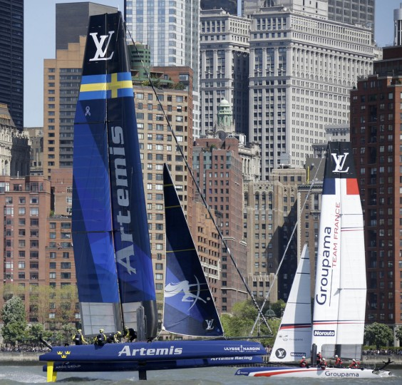 Artemis Racing of Sweden, left, sails past Groupama Team France during Race 1 at the America's Cup World Series sailing event in New York, Sunday, May 8, 2016. Emirates Team New Zealand won the N.Y. event. (AP Photo/Seth Wenig)