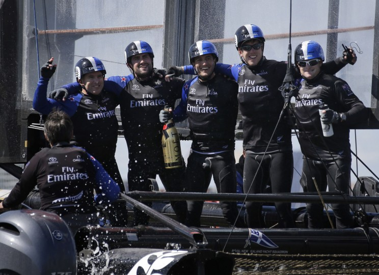 Emirates Team New Zealand crew members pose for a picture after winning the N.Y. race of the America's Cup World Series sailing event in New York, Sunday, May 8, 2016. (AP Photo/Seth Wenig)