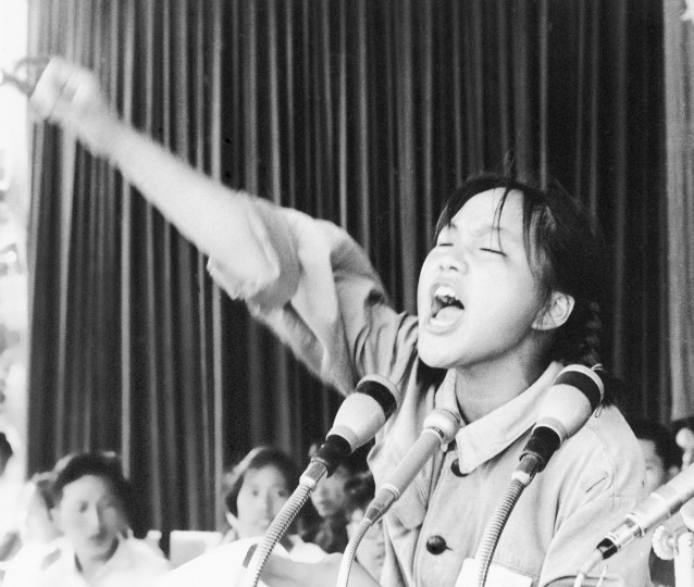In this file photo taken Aug. 10, 1966, a young woman identified only as Ms. Zhou calls out to embolden her fellow Red Guards in Beijing's Tiananmen Square at the start of the 1966-76 Cultural Revolution. On May 16, 1966, the Communist Party's Politburo produced a document announcing the start of what was formally known as the Great Proletarian Cultural Revolution to pursue class warfare and enlist the population in mass political movements. Launched by leader Mao Zedong, it set off a decade of tumult to revive communist goals and enforce a radical egalitarianism. (AP Photo, File)