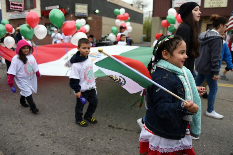 A large Mexican flag is carried down Vernor Hwy during the 52nd annual Cinco de Mayo parade Sunday, May 1, 2016, in Detroit's Southwest community. Cinco de Mayo commemorates the May 5, 1862 defeat of the invading French army by Mexican forces at Puebla. (Tanya Moutzalias/The Ann Arbor News via AP)