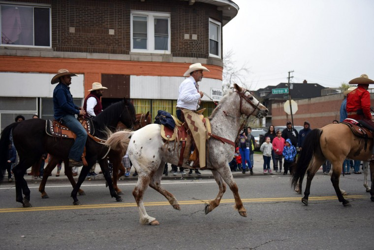 Horses make their way down Vernor Hwy during the 52nd annual Cinco de Mayo parade Sunday, May, 1, 2016, in Detroit's Southwest community. Cinco de Mayo commemorates the May 5, 1862 defeat of the invading French army by Mexican forces at Puebla. (Tanya Moutzalias/The Ann Arbor News via AP)