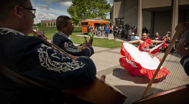 Walla Walla Community College student Vanesa Alvarado dances to traditional Mexican music provided by Mariachi Tapatio during the school's mid-day Cinco de Mayo celebration in Walla Walla, Wash., Thursday, May 5, 2016. (Greg Lehman/Walla Walla Union-Bulletin via AP)