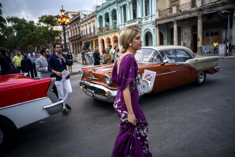 """Guests arrive to the presentation of fashion designer Karl Lagerfeld's """"cruise"""" line for fashion house Chanel, at the Paseo del Prado street in Havana, Cuba, Tuesday, May 3, 2016. With the heart of the Cuban capital effectively privatized by an international corporation under the watchful eye of the Cuban state, the premiere of Chanel 2016/2017 """"cruise"""" line offered a startling sight in a country officially dedicated to social equality and the rejection of material wealth. (AP Photo/Ramon Espinosa)"""
