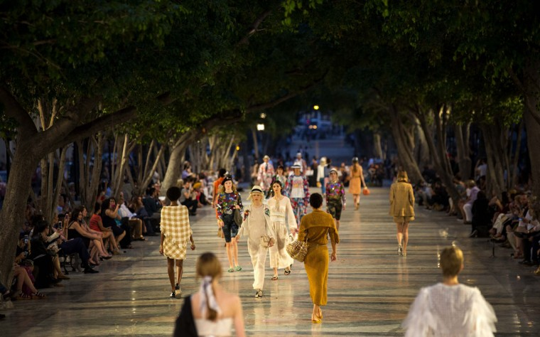 """Models wear creations from the Karl Lagerfeld """"cruise"""" line for fashion house Chanel, at the Paseo del Prado street in Havana, Cuba, Tuesday, May 3, 2016. With the heart of the Cuban capital effectively privatized by an international corporation under the watchful eye of the Cuban state, the premiere of Chanel 2016/2017 """"cruise"""" line offered a startling sight in a country officially dedicated to social equality and the rejection of material wealth. (AP Photo/Ramon Espinosa)"""