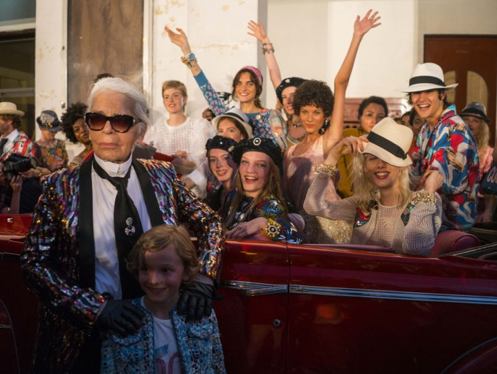 """Fashion designer Karl Lagerfeld, left, poses with the models who participated in the presentation of his """"cruise"""" line for fashion house Chanel, at the Paseo del Prado street in Havana, Cuba, Tuesday, May 3, 2016. With the heart of the Cuban capital effectively privatized by an international corporation under the watchful eye of the Cuban state, the premiere of Chanel 2016/2017 """"cruise"""" line offered a startling sight in a country officially dedicated to social equality and the rejection of material wealth. (AP Photo/Ramon Espinosa)"""