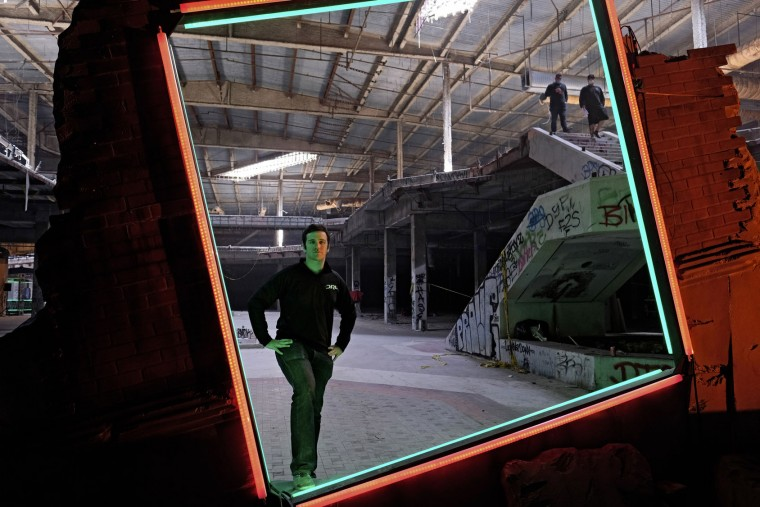"In this March 19, 2016, photo, Drone Racing League founder and CEO Nicholas Horbaczewski poses for a photo on the race course in a vacant mall in Hawthorne, Calif. Horbaczewski is betting he can the transform drone racing from a throw-down among hobbyists into a mainstream spectacle. ""To translate from a participatory sport to a professional sport that has a widespread audience, you have to put a lot of thought into how you're going to do that. And that's what we really focus on here at DRL,"" he said. (AP Photo/Richard Vogel)"