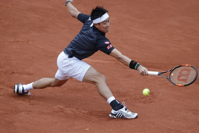 Japan's Kei Nishikori returns in the first round match of the French Open tennis tournament against Italy's Simone Bolelli at Roland Garros stadium in Paris, France, Sunday, May 22, 2016. (AP Photo/Michel Euler)