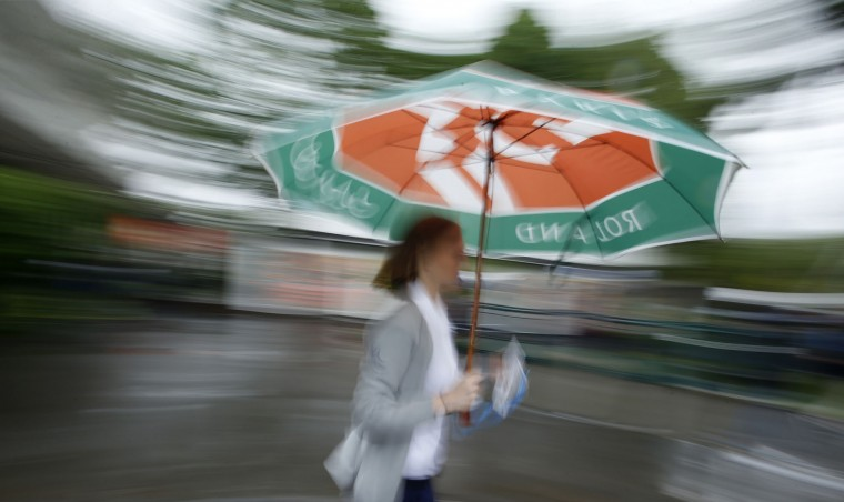 A woman walks in the alley of the Roland Garros stadium before the first round matches of the French Open tennis tournament, Sunday, May 22, 2016 in Paris. (AP Photo/Alastair Grant)