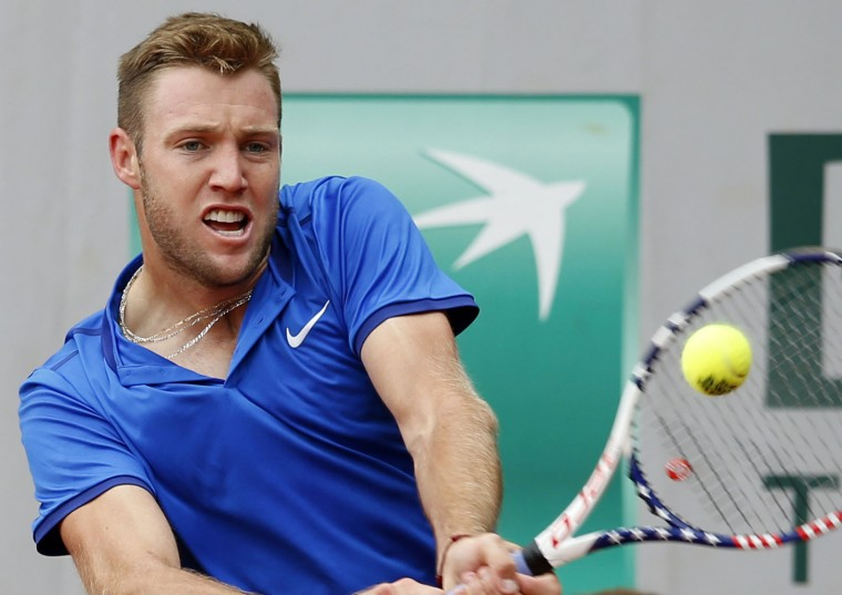 USA's Jack Sock returns the ball to The Netherlands' Robin Haase during their first round match of the French Tennis Open at the Roland Garros stadium, Sunday, May 22, 2016 in Paris. (AP Photo/Alastair Grant)