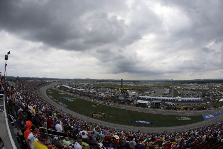 Storm clouds roll in as the NASCAR Talladega auto race begins at Talladega Superspeedway, Sunday, May 1, 2016, in Talladega, Ala. (AP Photo/John Bazemore)
