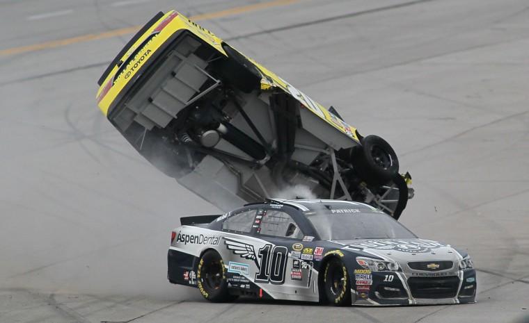 Matt Kenseth's car flips after Danica Patrick (10) crashed into him during the NASCAR Talladega auto race at Talladega Superspeedway, Sunday, May 1, 2016, in Talladega, Ala. (AP Photo/Greg McWilliams)