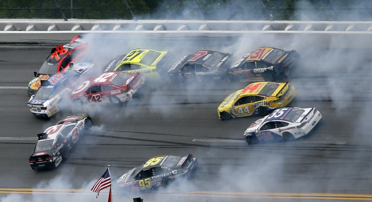 Several cars collide in a massive crash during the NASCAR Talladega auto race at Talladega Superspeedway, Sunday, May 1, 2016, in Talladega, Ala. (AP Photo/John Bazemore)