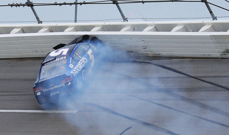 Kasey Kahne crashes into the wall during the NASCAR Talladega auto race at Talladega Superspeedway, Sunday, May 1, 2016, in Talladega, Ala. (AP Photo/Dale Davis)