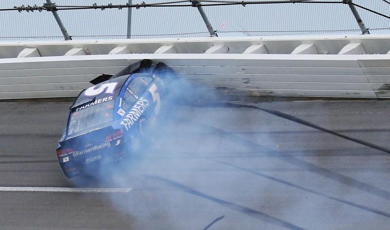 Kasey Kahne crashes into the wall during the NASCAR Talladega auto race at Talladega Superspeedway, Sunday, May 1, 2016, in Talladega, Ala. (AP Photo/Dale Davis)