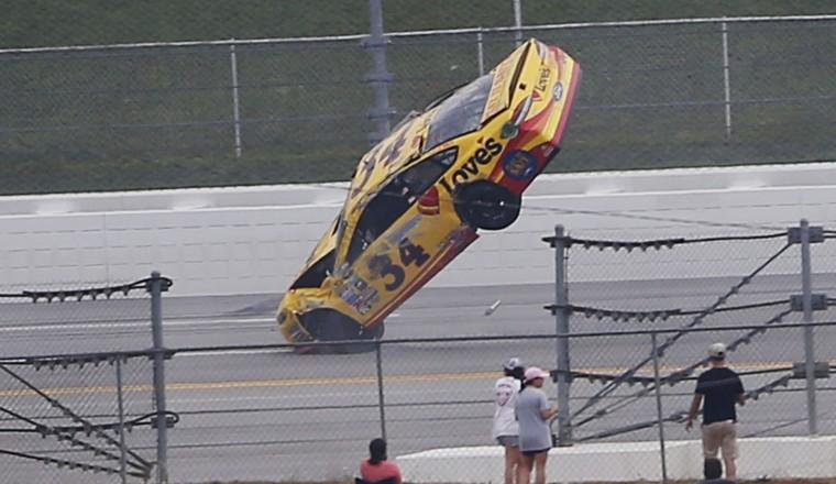 Chris Buescher wrecks during the NASCAR Talladega auto race at Talladega Superspeedway, Sunday, May 1, 2016, in Talladega, Ala. (AP Photo/John Bazemore)