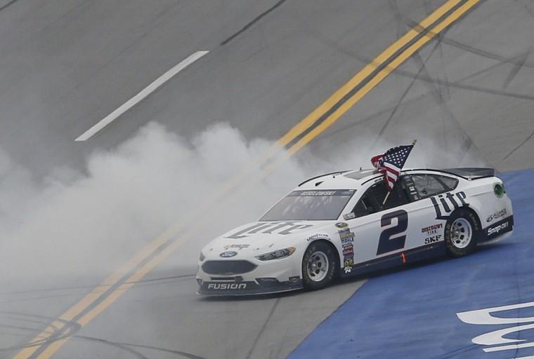 Brad Keselowski burns out and celebrates after winning during the NASCAR Talladega auto race at Talladega Superspeedway, Sunday, May 1, 2016, in Talladega, Ala. (AP Photo/John Bazemore)