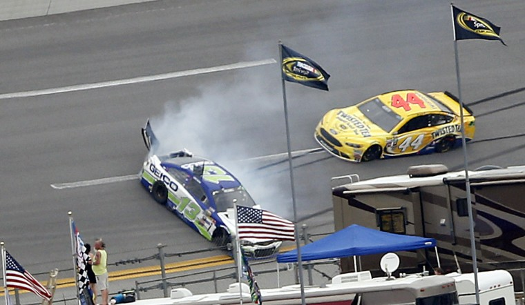 Casey Mears (13) wrecks during the NASCAR Talladega auto race at Talladega Superspeedway, Sunday, May 1, 2016, in Talladega, Ala. (AP Photo/John Bazemore)