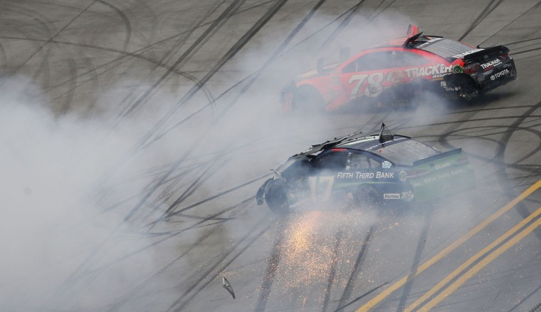 NASCAR drivers Martin Truex Jr. (78) and driver AJ Allmendinger (47) wreck at the end of the race during the NASCAR Talladega auto race at Talladega Superspeedway, Sunday, May 1, 2016, in Talladega, Ala. (AP Photo/John Bazemore)