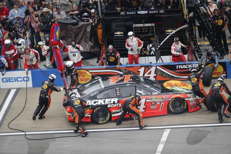 NASCAR driver Tony Stewart stops in the pit during the NASCAR Talladega auto race at Talladega Superspeedway, Sunday, May 1, 2016, in Talladega, Ala. (AP Photo/John Bazemore)