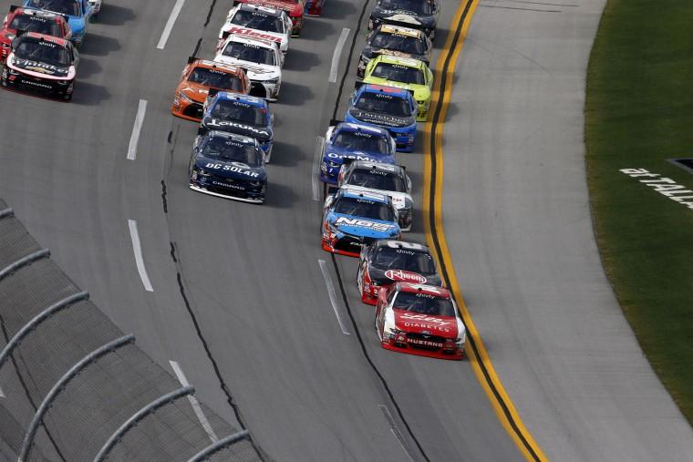 Race car drivers round the track during NASCAR Xfinity Series auto race at Talladega Superspeedway, Saturday, April 30, 2016, in Talladega, Ala. (AP Photo/John Bazemore)