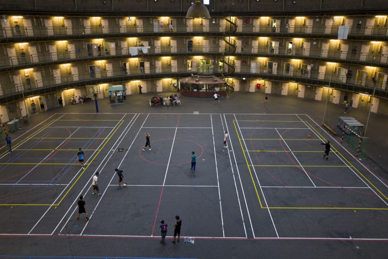 Refugees and migrants play football at the former prison of De Koepel in Haarlem, Netherlands. With crime declining in the Netherlands, the country is looking at new ways to fill its prisons. (AP Photo/Muhammed Muheisen)