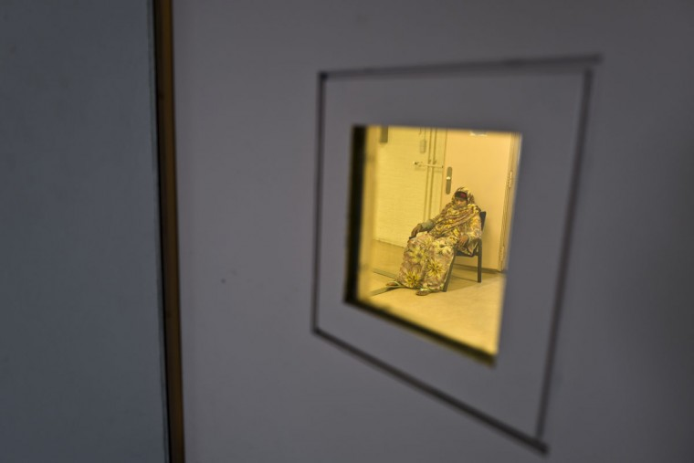 Somali migrant Ijaawa Mohamed, 41, sits on a chair outside a room at the women's section of the former prison of De Koepel in Haarlem, Netherlands. With crime declining in the Netherlands, the country is looking at new ways to fill its prisons. (AP Photo/Muhammed Muheisen)