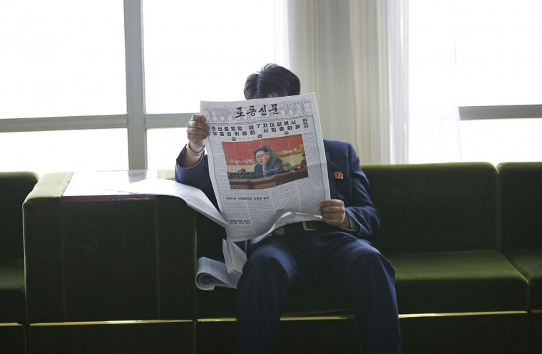 A North Korean reads the country's leader Kim Jong Un's speech published in the local newspaper on Sunday, May 8, 2016, in Pyongyang, North Korea. North Korean leader Kim Jong Un said during a critical ruling party congress that his country will not use its nuclear weapons first unless its sovereignty is invaded, state media reported. (AP Photo/Kim Kwang Hyon)