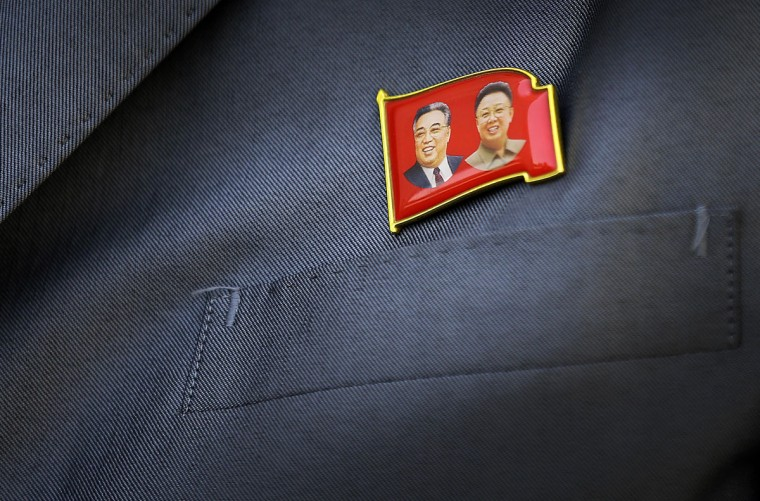 A pin of the late North Korea leaders Kim Il Sung, left, and Kim Jong Il is displayed on North Korean man's suit Saturday, May 7, 2016 in Pyongyang, North Korea. North Korean leader Kim Jong Un hailed his country's recent nuclear test to uproarious applause as he convened the first full congress of its ruling party since 1980, an event intended to showcase the North's stability and unity in the face of tough international sanctions and deepening isolation. (AP Photo/Wong Maye-E)