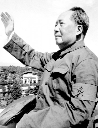 In this file photo taken in 1966, Mao Zedong waves at the beginning of China's Cultural Revolution. On May 16, 1966, the Communist Party's Politburo produced a document announcing the start of what was formally known as the Great Proletarian Cultural Revolution to pursue class warfare and enlist the population in mass political movements. Launched by leader Mao Zedong, it set off a decade of tumult to revive communist goals and enforce a radical egalitarianism. (AP Photo, File)