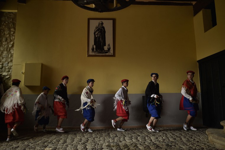 Dancers of the ''Bread Procession of the Saint'' take part in a ceremony in honor of Domingo de La Calzada Saint (1019-1109) in Santo Domingo de La Calzada, northern Spain, Wednesday, May 11, 2016. Every year during spring season, ''Las Doncellas'' (White Virgins), hold on their head a basket cover with white cloth while they walk past along of this old village in honor of the saint. (AP Photo/Alvaro Barrientos)