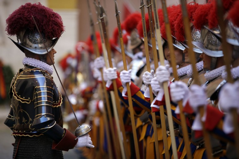 New Vatican Swiss Guards line up during a swearing-in ceremony, at the Vatican, Friday, May 6, 2016. The ceremony is held each May 6 to commemorate the day in 1527 when 147 Swiss Guards died protecting Pope Clement VII during the Sack of Rome. (AP Photo/Andrew Medichini)