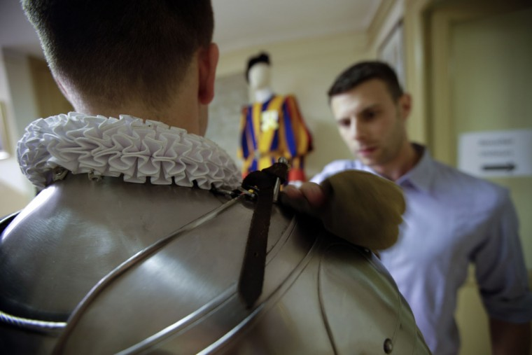 A new Vatican Swiss Guards has his armor polished prior to a swearing-in ceremony, at the Vatican, Friday, May 6, 2016. The ceremony is held each May 6 to commemorate the day in 1527 when 147 Swiss Guards died protecting Pope Clement VII during the Sack of Rome. (AP Photo/Andrew Medichini)