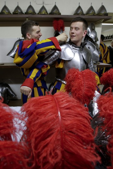 New Vatican Swiss Guards wear their uniforms and armors prior to a swearing-in ceremony, at the Vatican, Friday, May 6, 2016. The ceremony is held each May 6 to commemorate the day in 1527 when 147 Swiss Guards died protecting Pope Clement VII during the Sack of Rome. (AP Photo/Andrew Medichini)