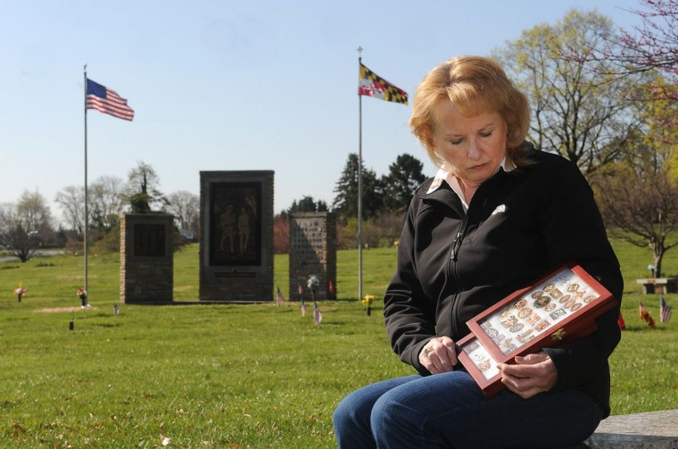 Karen Nizer, a retired Baltimore County police officer, holds her collection of Fallen Heroes Medals. (Barbara Haddock Taylor/Baltimore Sun)