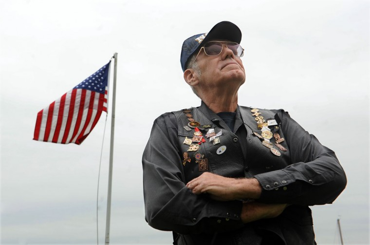 William Renshaw wears a vest with every pin from Fallen Heroes Day in honor of his brother-in-law, Henry Rayner Jr., who was killed in the line of duty and was honored in the first Fallen Heroes ceremony in 1984. (Barbara Haddock Taylor/Baltimore Sun)